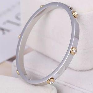 Henri Bendel Silver Crystal Hinged Bangle Bracelet